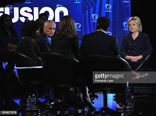 Journalists Akilah Hughes and Jorge Ramos with democratic presidential candidate Hillary Rodham Clinton onstage during the FUSION presents the Brown...
