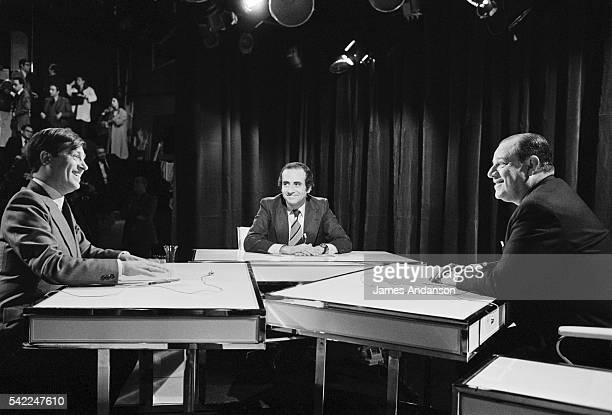 Journalists Alain Duhamel and JeanPierre Elkabbach interview French Prime Minister Raymond Barre during the political television show 'Cartes sur...