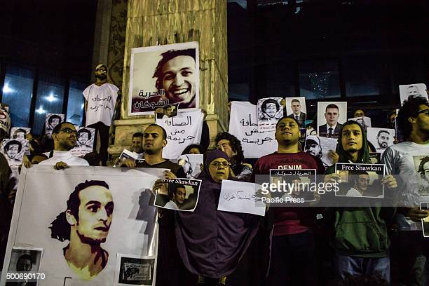 Journalists and activists bring placards and shout slogans as they gather in front of the Press Syndicate in Cairo demanding the release of jailed...