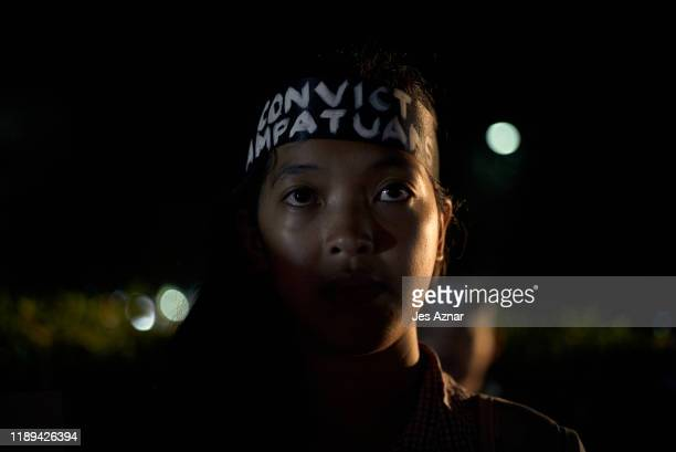Journalists and activists gather to hold a vigil on the eve of the promulgation of the Ampatuan massacre trial on December 18 2019 in Manila...