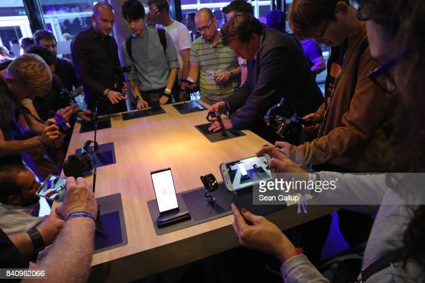 Journalists and bloggers get a closer look at the Galaxy Note 8 smartphone and the Gear Fit2 Pro sports wrist band at the Samsung press conference...