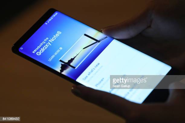 Journalists and bloggers get a closer look at the Galaxy Note 8 smartphone at the Samsung press conference ahead of the IFA consumer electronics fair...