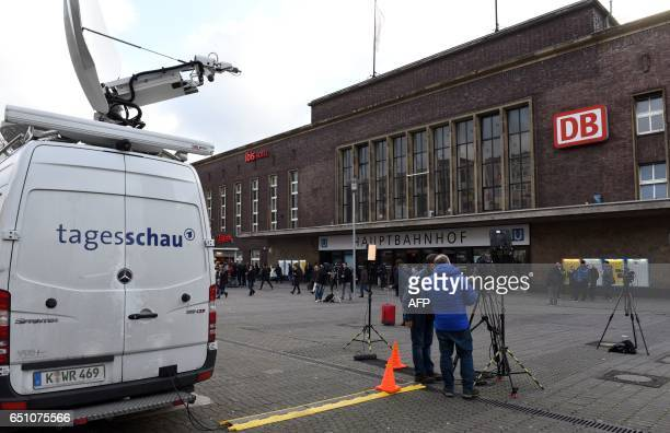 Journalists and cameramen stand in front of the main train station of Duesseldorf western Germany on March 10 one day after German police have...