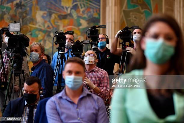 Journalists and cameramen wearing protective masks attend a joint press conference of Hungarian Prime Minister and Serbian President in Belgrade on...