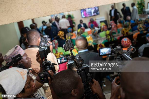Journalists and media surround the recently released girls from Chibok in Abuja on May 8, 2017. The United Nations on May 8, 2017 welcomed the...