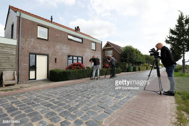Journalists and medias stand in front of the house of the 22yearold suspect who was arrested in Langeweg The Netherlands on August 24 following a...