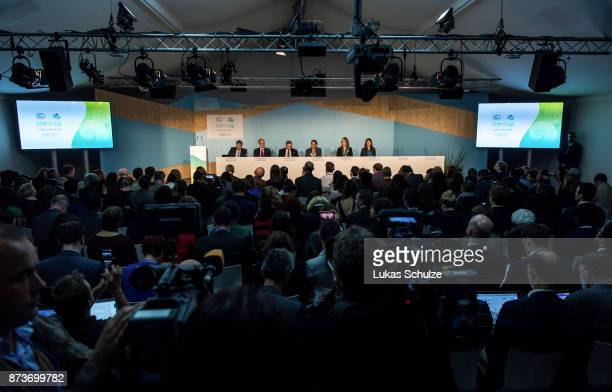Journalists and member of delegations attend an event titled 'The Role of Cleaner and More Efficient Fossil Fuels and Nuclear Power in Climate...