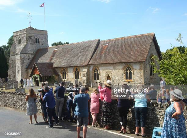 Journalists and members of the public outside St Mary the Virgin Church in Frensham Surrey during the wedding of Charlie van Straubenzee and Daisy...