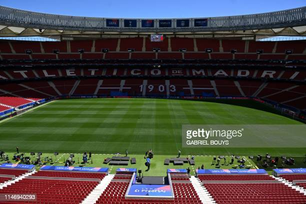Journalists and officials visit the Wanda Metropolitan Stadium in Madrid on May 30 2019 ahead of the UEFA Champions League final football match...