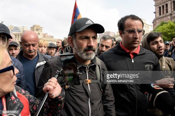 Journalists and opposition supporters stand outside the hotel where Armenia's antigovernment protest leader Nikol Pashinyan meets with Armenian Prime...