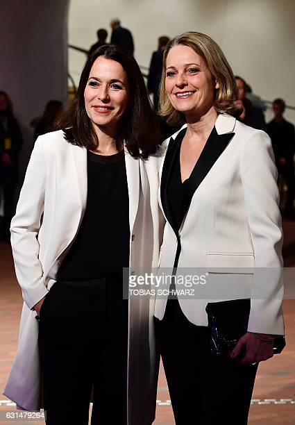 Journalists and partners Anne Will and Miriam Meckel arrive for the opening of the Elbphilharmonie concert hall in Hamburg northern Germany on...