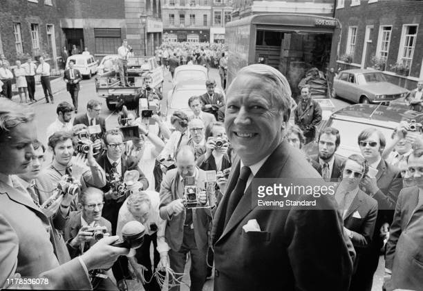 Journalists and photographers gather around British Conservative Party politician Edward Heath who is moving to the Prime Minister's Office 10...