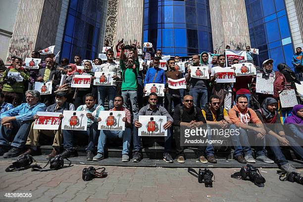 Journalists and photojournalists demonstrate in front of the journalist's syndicate in Cairo against repeated attacks on press members in Egypt on...