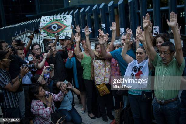 Journalists and social activists protest during a demonstration against alleged government spying on journalists and human rights defenders outside...