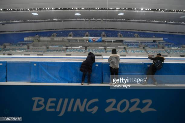 Journalists and staff visit the National Speed Skating Oval, a new venue built for the 2021 Beijing Winter Olympics during an organized tour on...