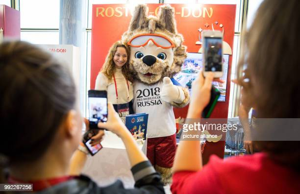 Journalists and volunteers taking pictures with the wolf 'Zabivaka' the official mascot of the Russia 2018 FIFA World Cup in the Kremlin Palace's...