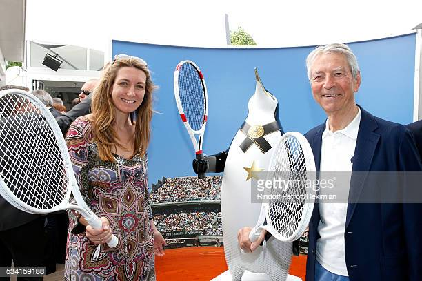 Journalists AnneClaire Coudray and JeanClaude Narcy attend the 2016 French Tennis Open Day Four at Roland Garros on May 25 2016 in Paris France