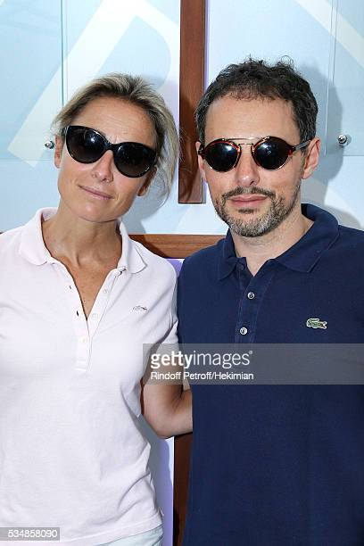 Journalists AnneSophie Lapix and MarcOlivier Fogiel attend Day Seven of the 2016 French Tennis Open at Roland Garros on May 28 2016 in Paris France