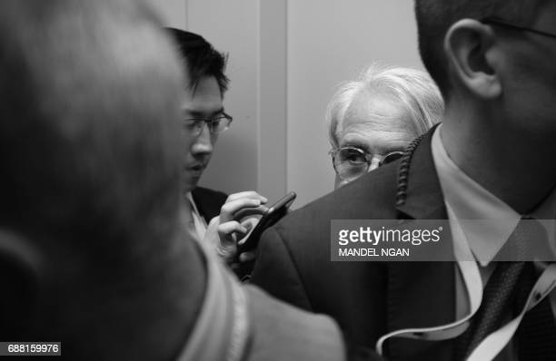 Journalists are crowded into a freight elevator in the European Union Headquarters after covering a meeting between US President Donald Trump and...