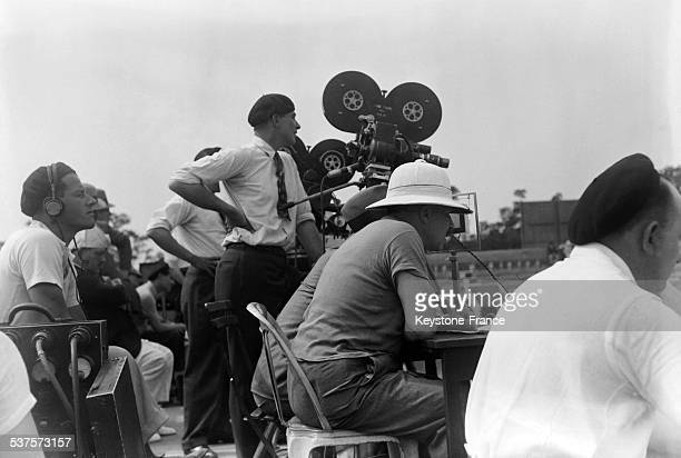 Journalists are filming and commenting the matches of the Davis Cup at Roland Garros in July 1933 in Paris France