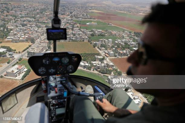 Journalists are given a press tour in a Lebanese Air Force Robinson R44 Raven II taking off from Rayaq military air base to Zahle in the Bekaa Valley...