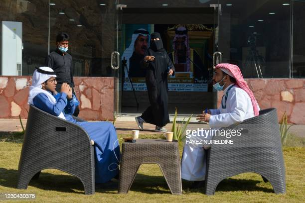 Journalists are pictured at the media centre ahead of the 41st Gulf Cooperation Council summit in the city of al-Ula in northwestern Saudi Arabia on...