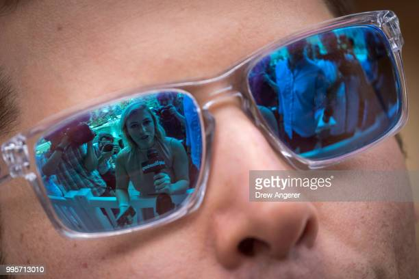 Journalists are reflected in the sunglasses of Sam Altman president of Y Combinator and founder of political initiative United Slate as he speaks to...