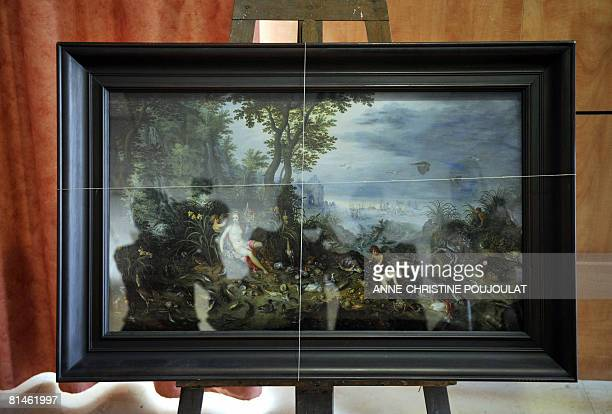 Journalists are reflected in the window glass taking pictures on June 05 2008 in Marseille southern France of a Jan Bruegel's painting 'Allegorie de...