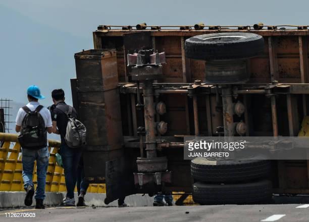 TOPSHOT Journalists are seen at the blocked Tienditas bridge in Urena Venezuela on the border with Colombia on February 20 2019 Nicolas Maduro's...