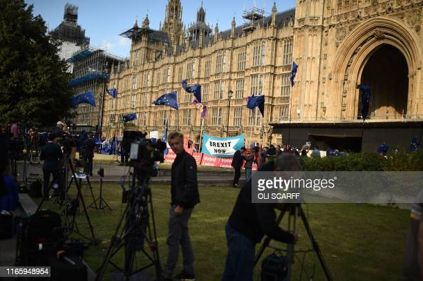 Journalists are seen at the temporary media broadcast tents near the Houses of Parliament in central London on September 4 2019 British Prime...