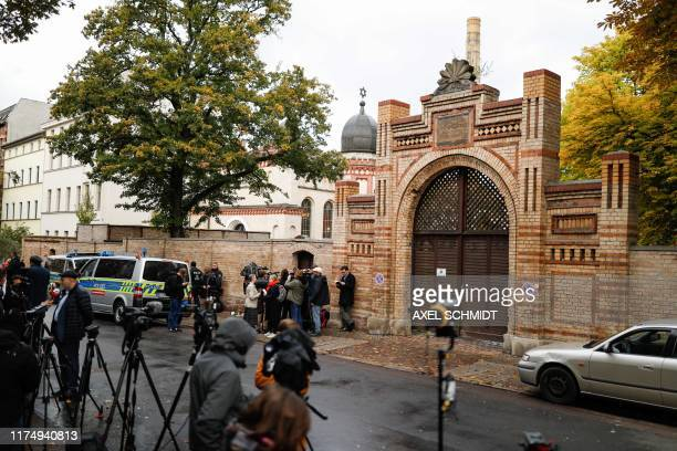 Journalists are seen on October 10 2019 at synagogue in Halle eastern Germany one day after the attack where two people were shot dead At least two...