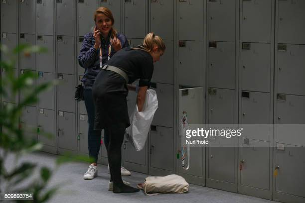 Journalists are seen using lockers at the press center located in the Hamburg Messe und Congress center on 6 July 2017 where the 2017 G20 meeting...