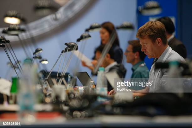 Journalists are seen working at the press center in the Hamburg Messe on 6 July 2017 ahead of the 2017 G20 meeting