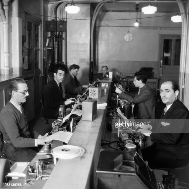 Journalists are seen working in an editorial office at Agence France Presse headquarters in Paris in December 1946.