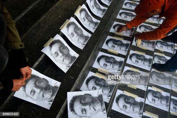 Journalists arrange pictures of slain Mexican colleague Candido Rios during a demonstration demanding for justice at the headquarters of the Ministry...