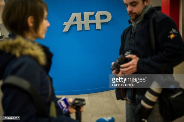Journalists arrive at the Agence France Presse headquarters in Paris on January 4 2013 AFP PHOTO FRED DUFOUR
