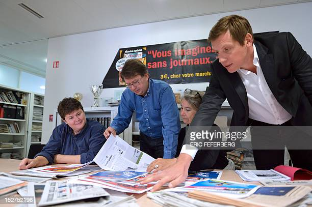 Journalists at Courrier International weekly Newspaper edition editor in chief Claire Carrard editorial director Eric Chol technical editor in chief...