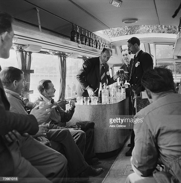 Journalists at the bar in the press coach at the Monte Carlo rally 1954 In the background is John Field editor of 'Transport' Original publication...
