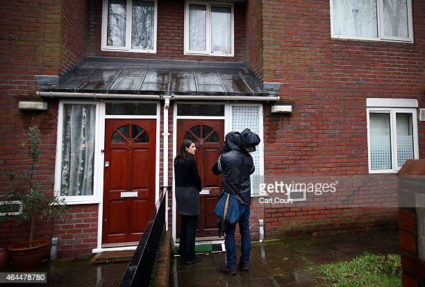 Journalists attempt to speak with residents of the home where Islamic State militant Mohammed Emwazi, who has come to be known as Jihadi John, is...