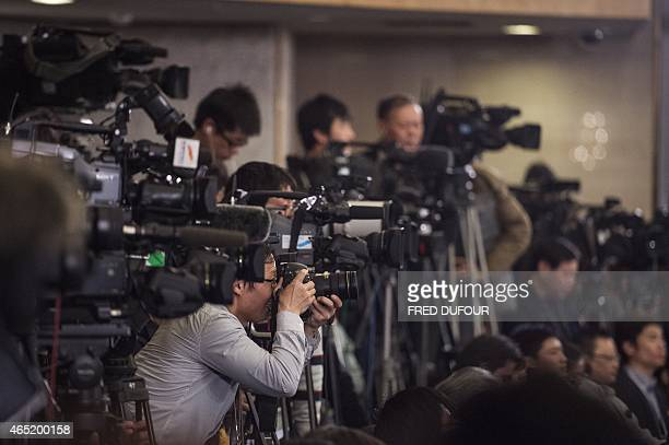 Journalists attend a news conference by National People's Congress spokeswoman Fu Ying at the Great Hall of the People in Beijing on March 4 2015...
