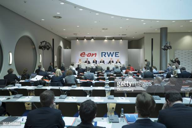 Journalists attend a news conference with the management boards of German energy companies EON SE and RWE AG in Essen Germany on Tuesday March 13...