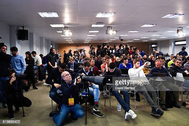 Journalists attend a press conference ahead of the FC Barcelona UEFA Champions Leage round of 16 second leg match against Arsenal FC at Ciutat...