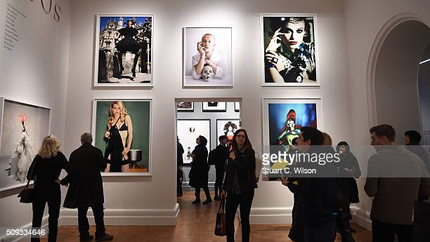 Journalists attend the press preview for 'Vogue 100 A Century of Style' exhibiting the photographs that has been commissioned by British Vogue since...