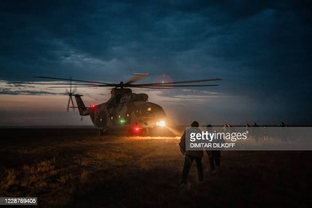 Journalists board a military transport helicopter after the end of military exercises at the Kapustin Yar range in Astrakhan region, Southern Russia...