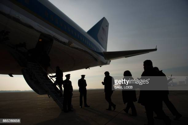 Journalists board Air Force One as US President Donald Trump departs from Andrews Air Force Base in Maryland December 4 travelling to Salt Lake City...
