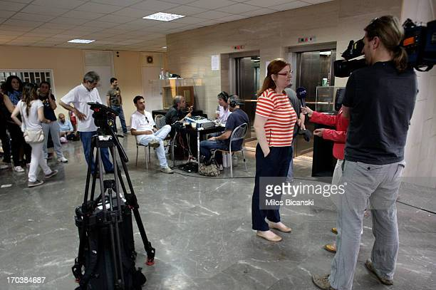 Journalists broadcast from an improvised studio situated in the main hall of the headquarters of the Greek public broadcaster ERT on June 12 2013 in...