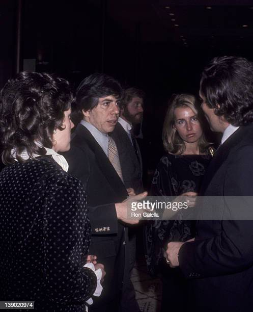 Journalists Carl Bernstein and Bob Woodward and wife Kathleen Woodward attend the premiere of All The President's Men on April 4 1976 in Washington DC