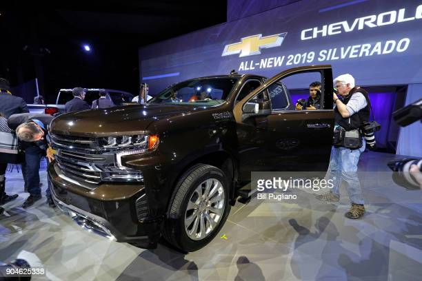 Journalists check out the new 2019 Chevrolet Silverado 1500 after its official debut at the 2018 North American International Auto Show January 13...