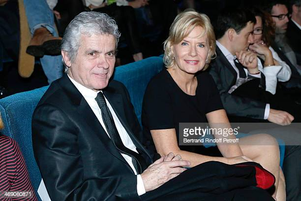 Journalists Claude Serillon and his wife Catherine Ceylac attend the 'Monuments Men' Premiere at Cinema UGC Normandie on February 12 2014 in Paris...