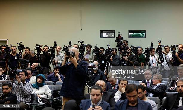 Journalists cover a press conference of German Foreign Minister FrankWalter Steinmeier and the Foreign Minister of Iran Mohammad Javad Zarif on...